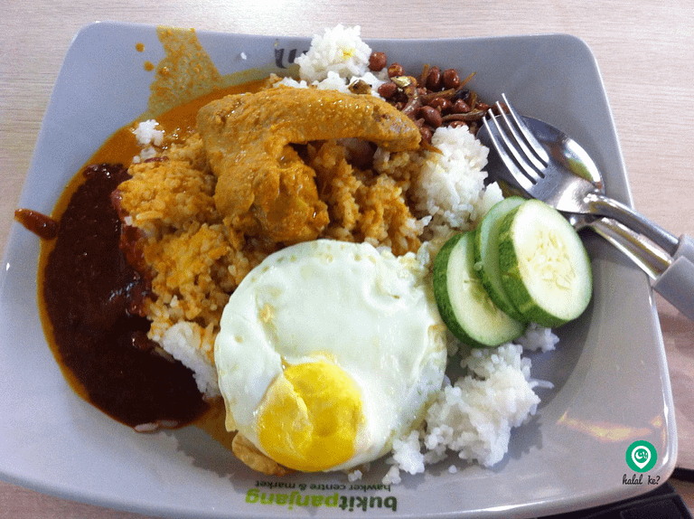 Customers can opt for Chicken Curry to go along with their Nasi Lemak at Bukit Panjang Hawker Centre, Singapore